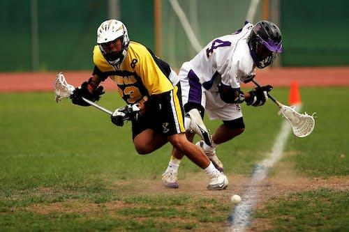 Foto d'estoc gratuïta de acció, atletes, bola, camp