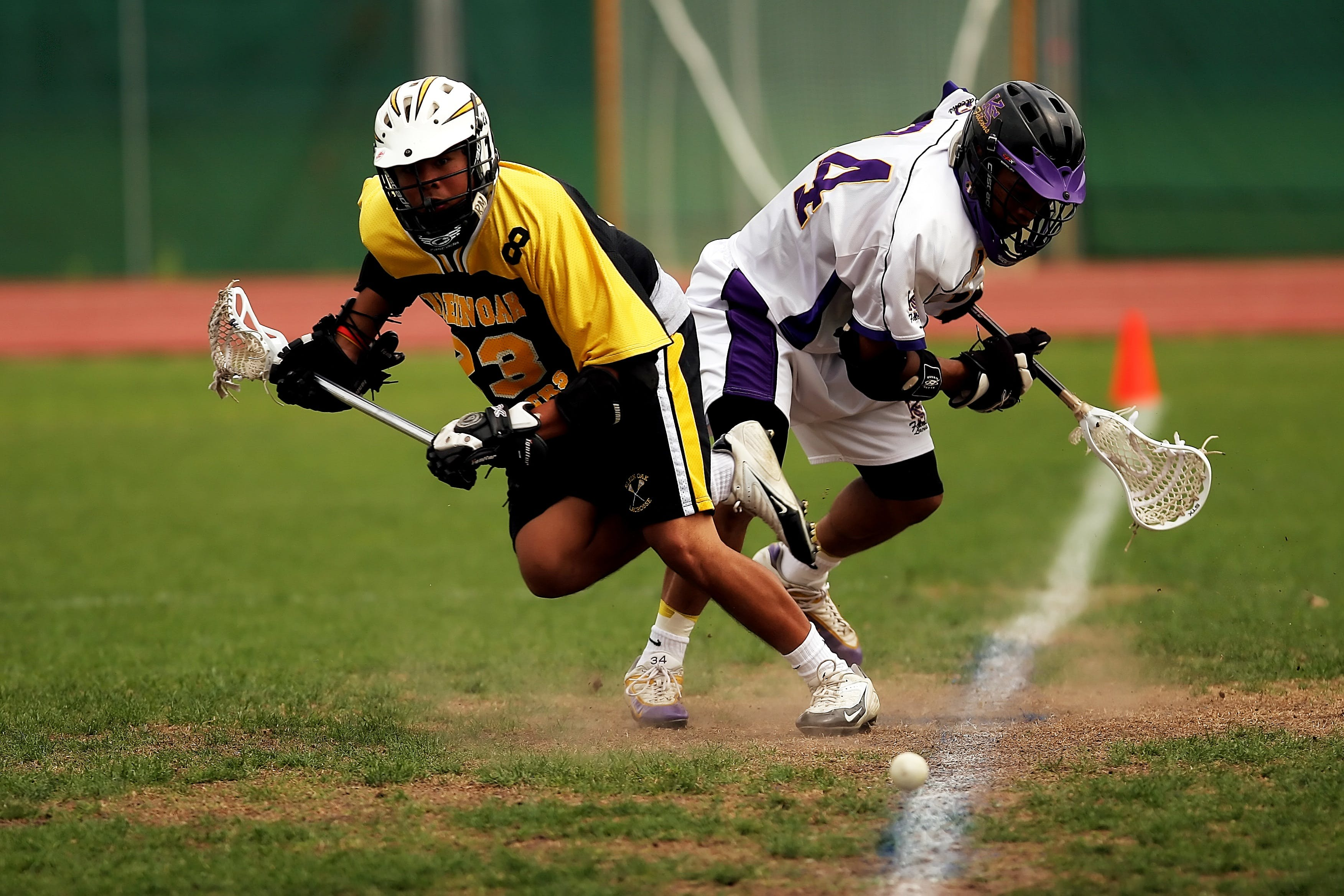 Man Wearing Yellow and Black Sport Jersey Holding Lacrosse ...