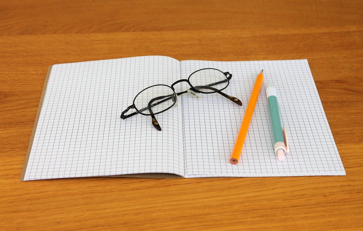 Black Framed Eyeglass on Graphing Paper