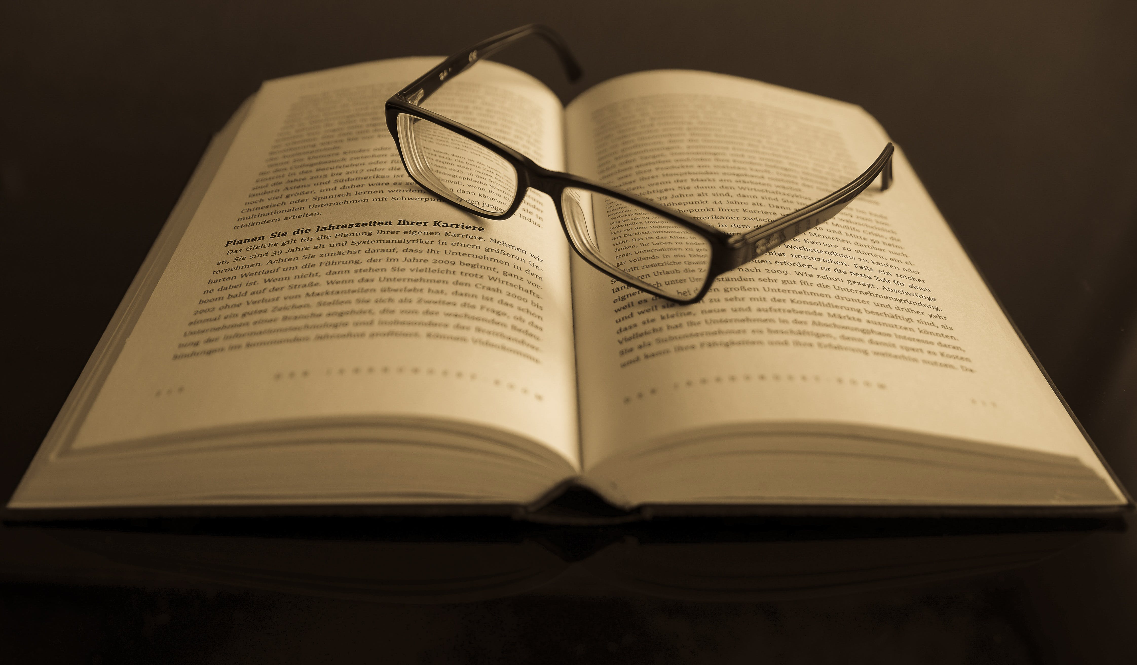 Black Frame Eyeglass in White Printed Book Page