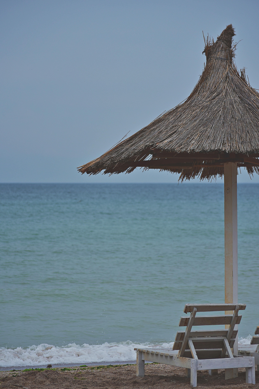 Patio Umbrella Beside Deck Chair Near Seashore