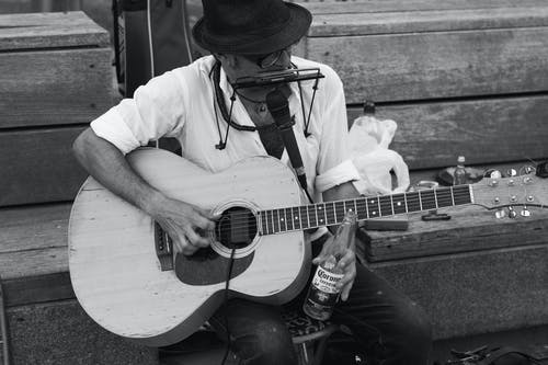 Monochrome Photo of Man Playing Guitar
