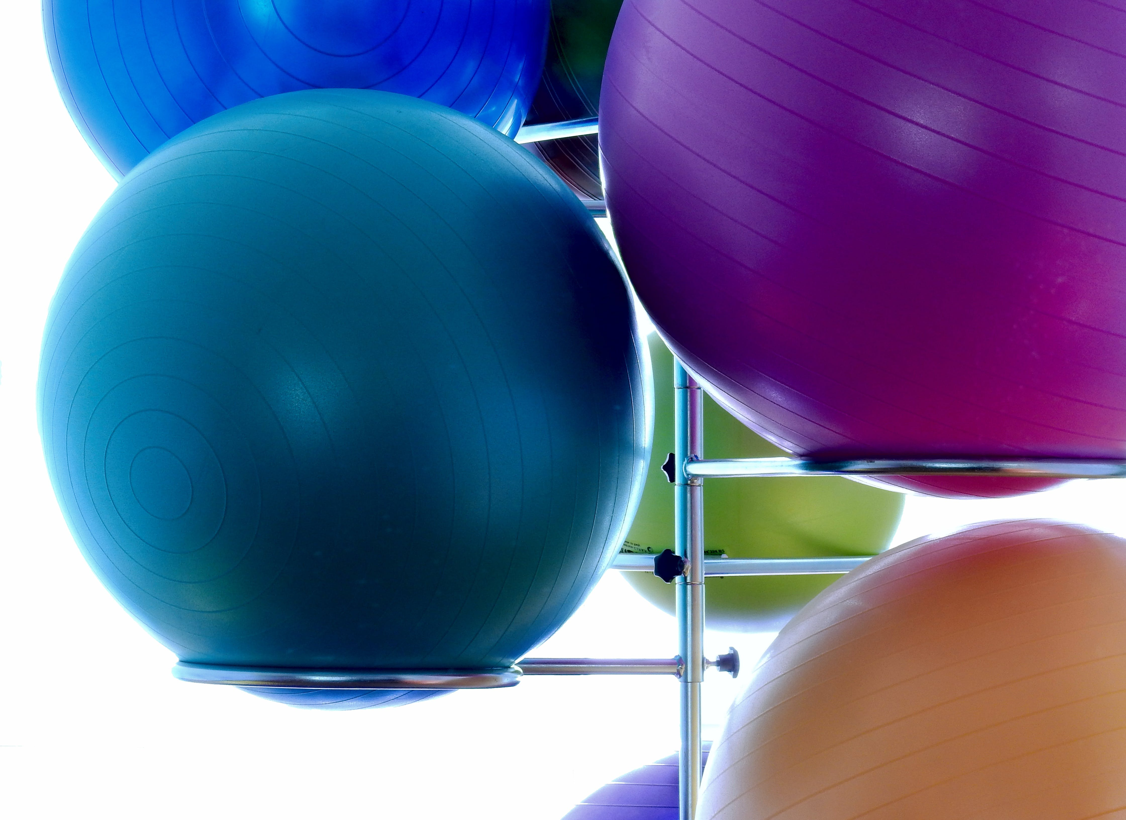 Blue Exercising Ball on Stainless Steel Exercising Ball Rack
