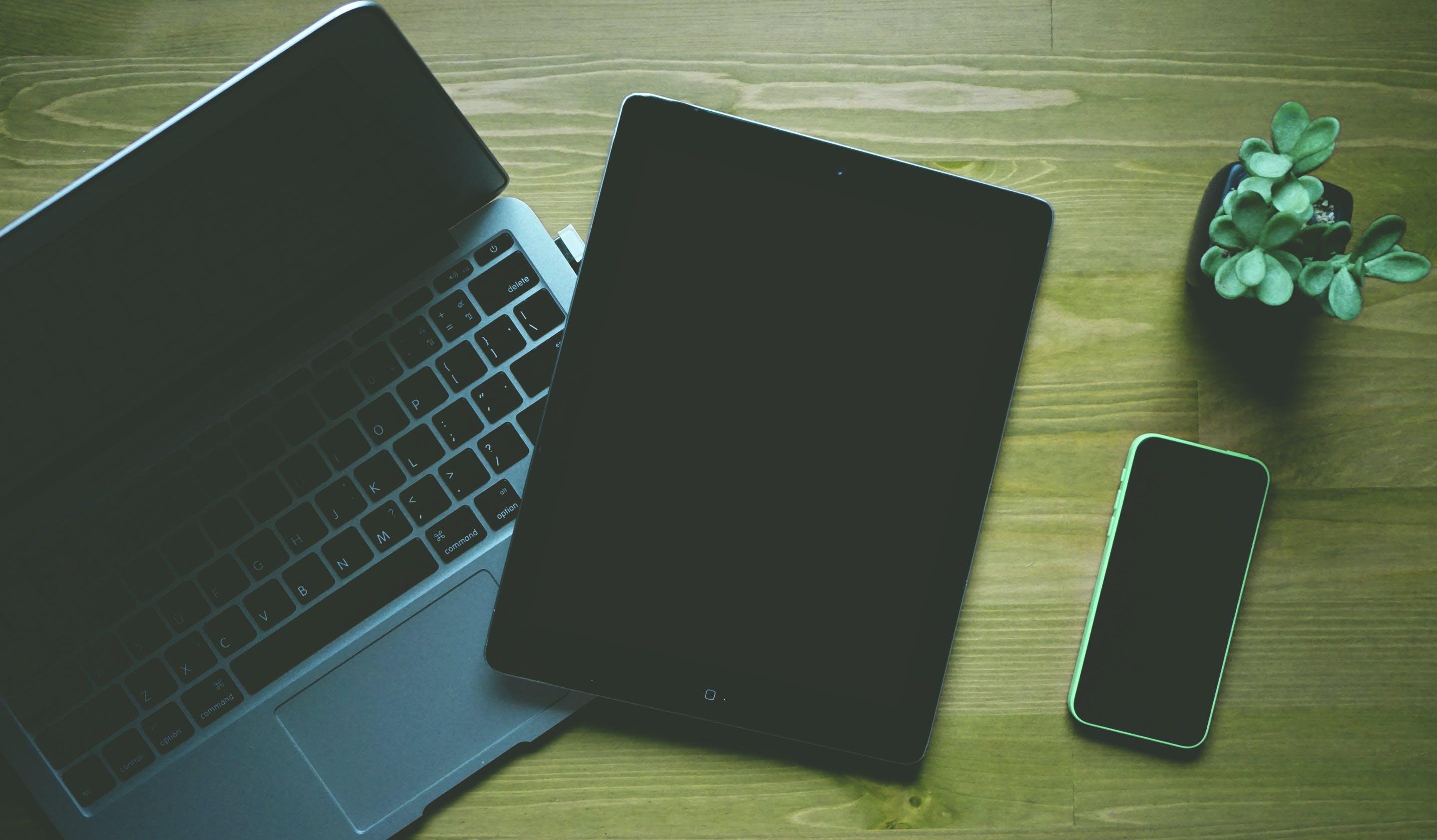 Black Ipad Beside Green Iphone 5c