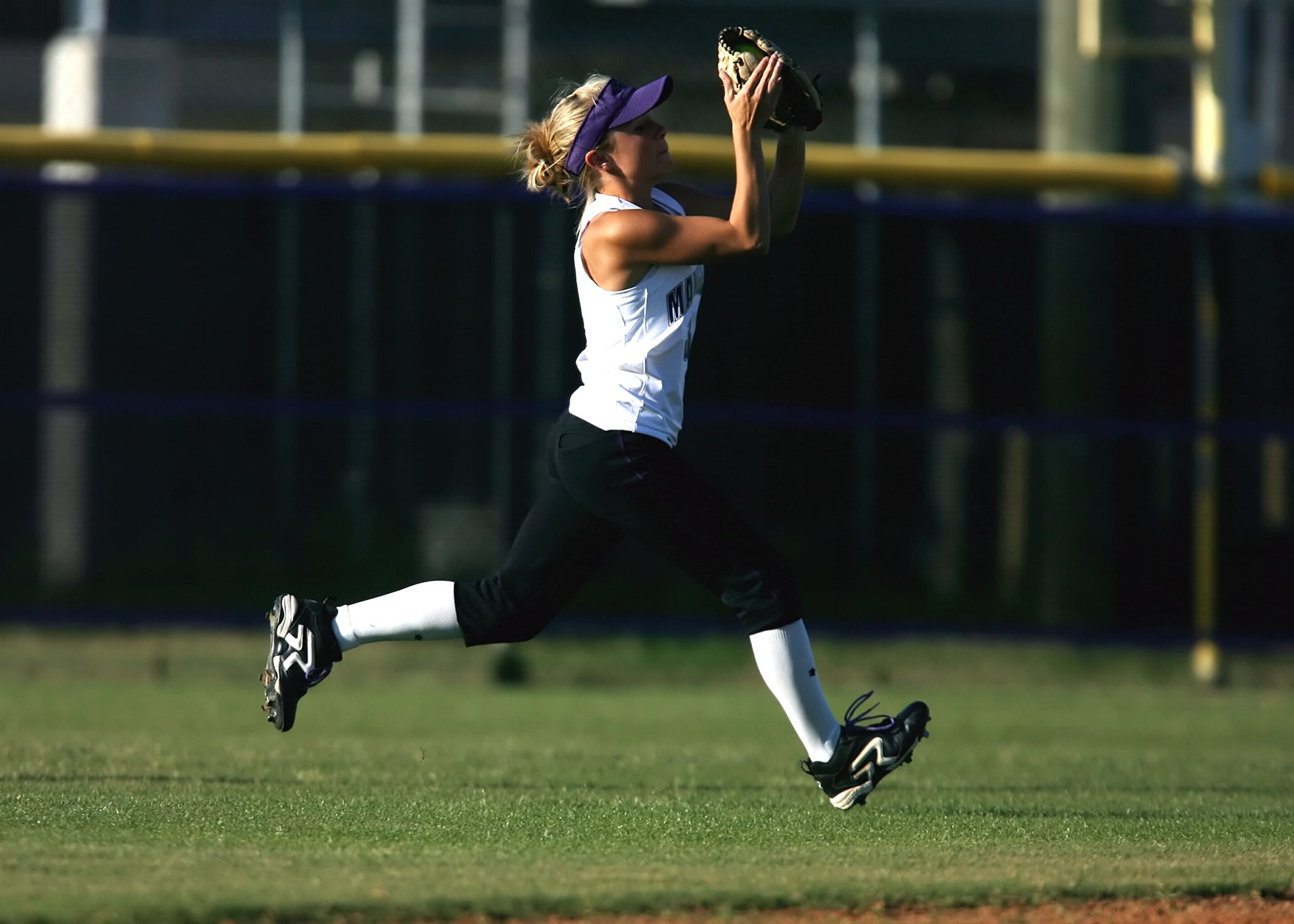 Woman in White Sleeveless Shirt Playing Softball