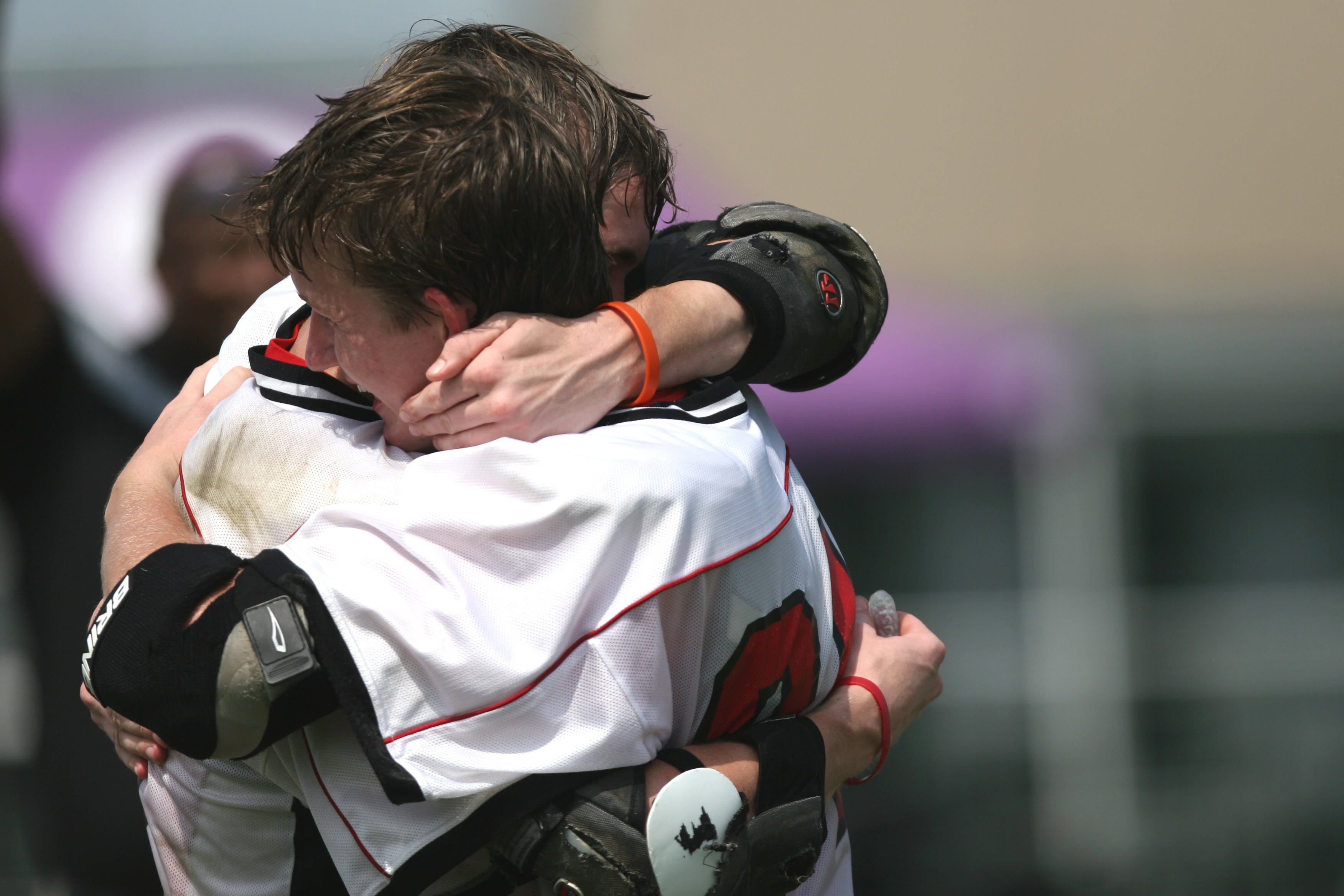 Sports Players Hugging