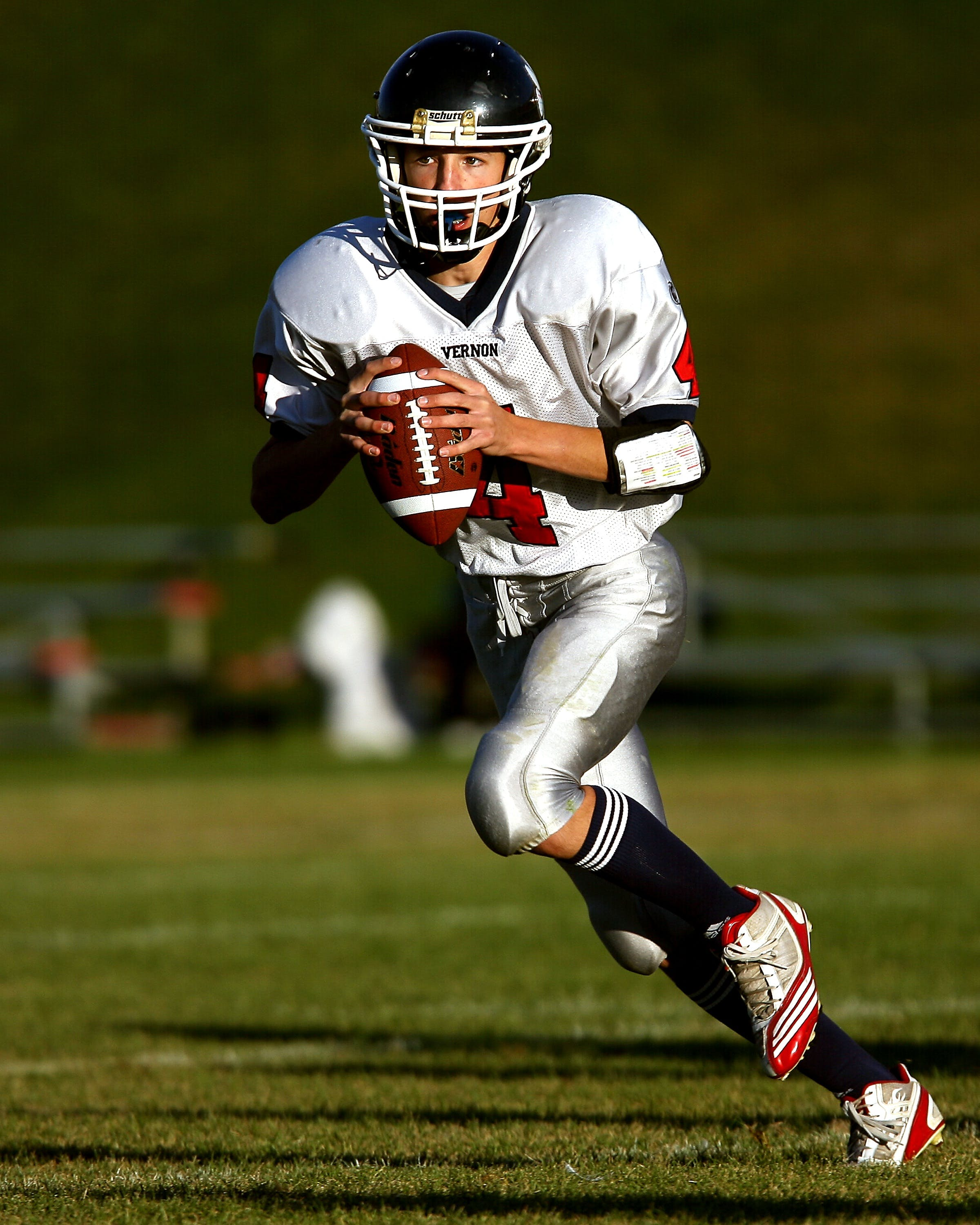 Man Holding Football While Running