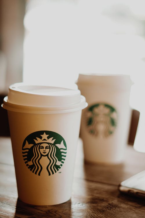 Close-Up Photo of Starbucks Paper Cup