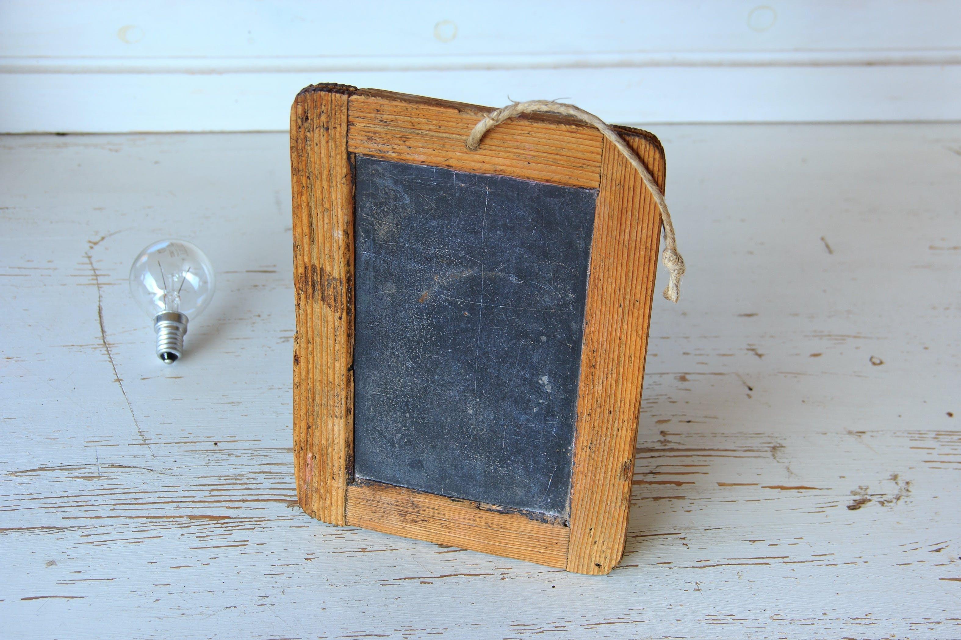 Brown Wooden Rectangular Photo Frame on White Wooden Table
