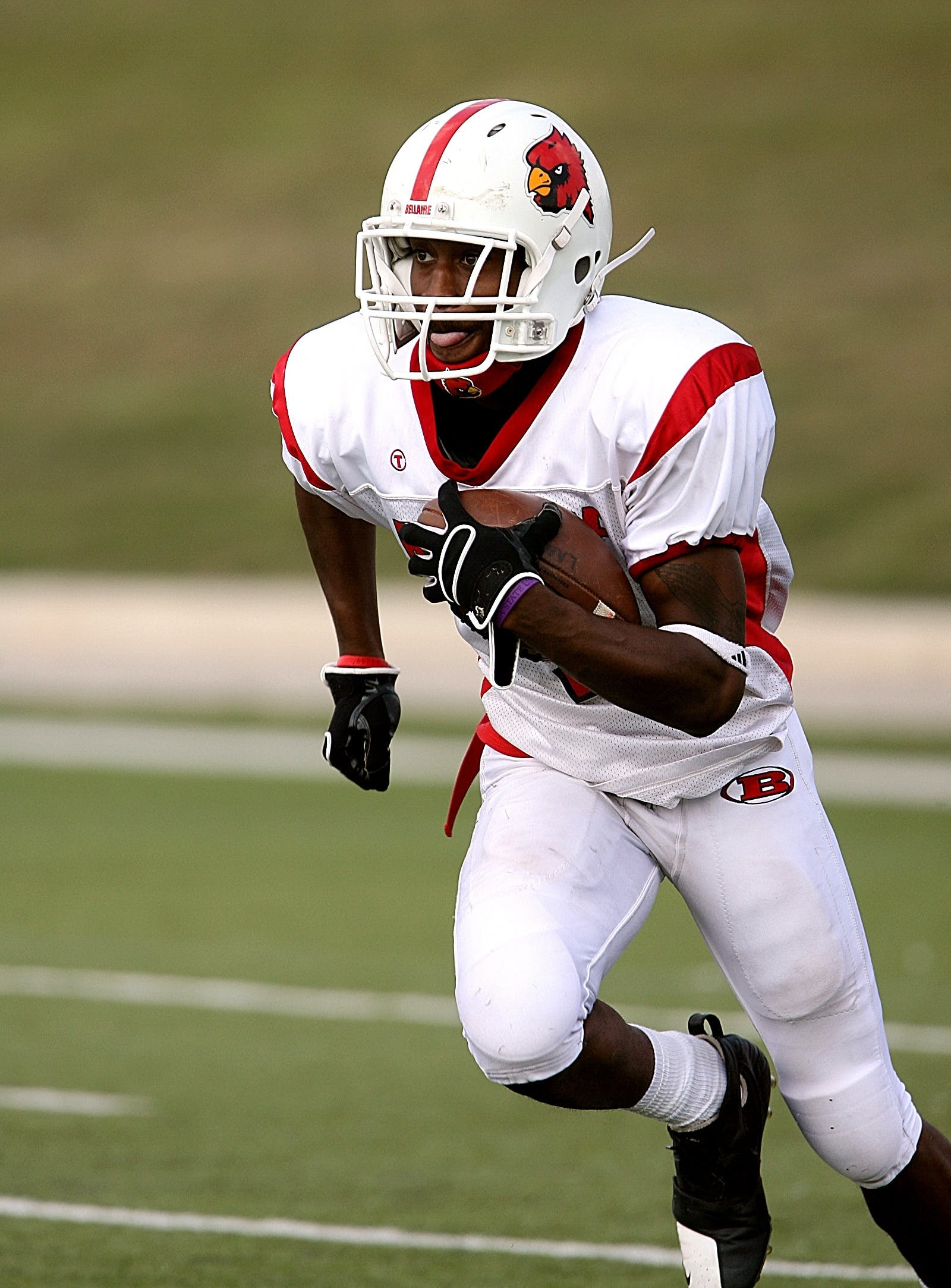 Football Player Running on Football Field
