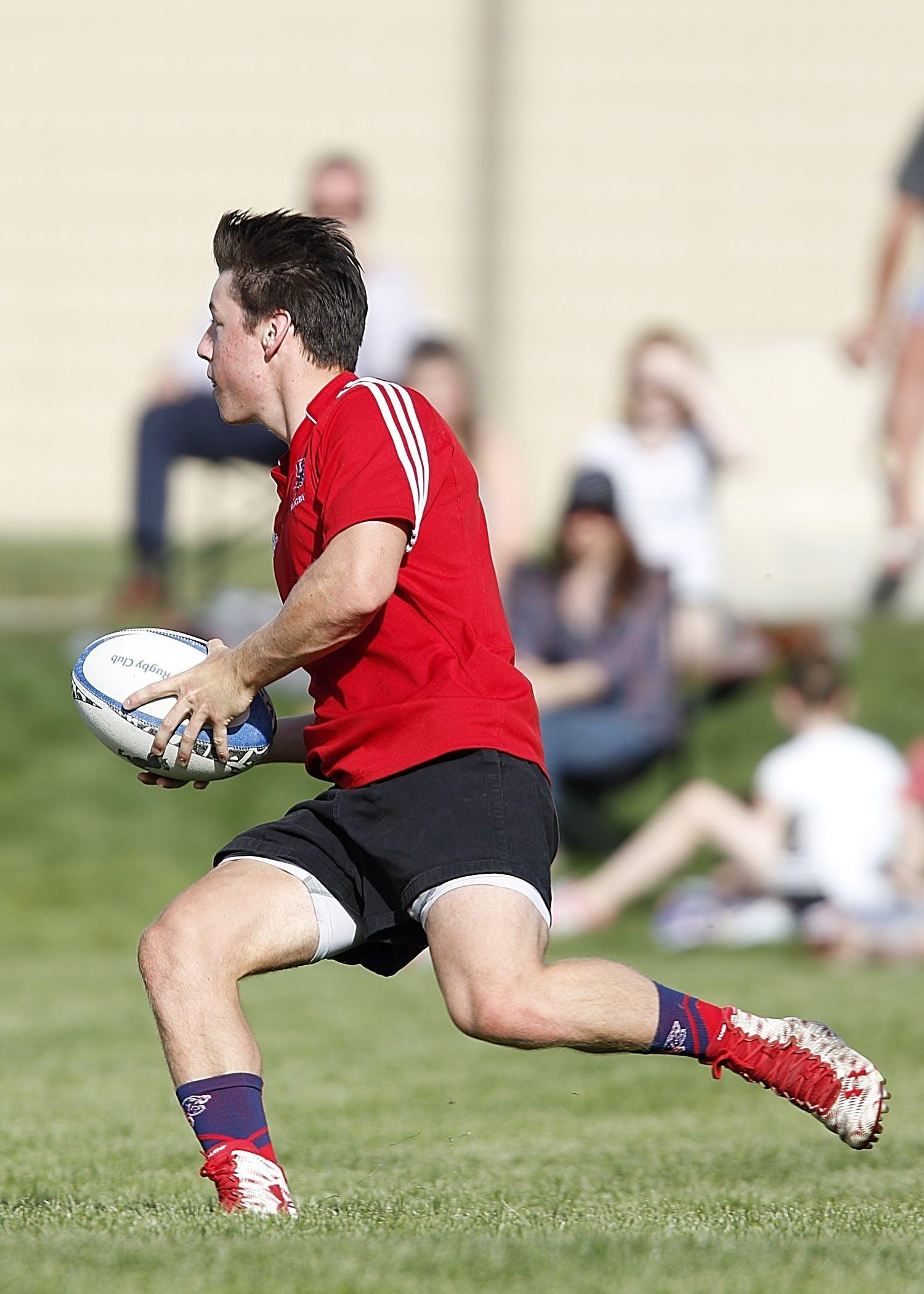 Man Playing Rugby at Daytime