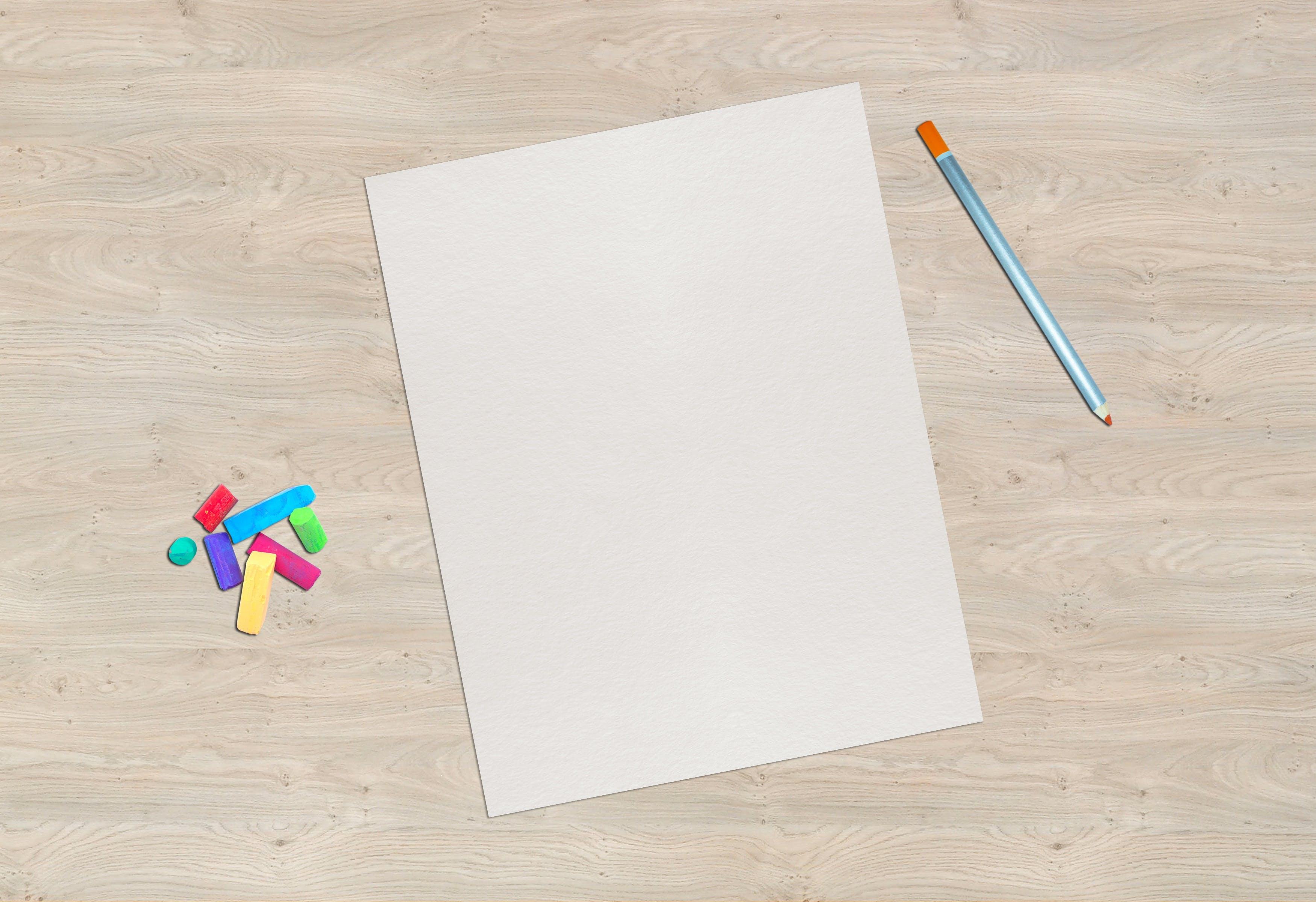 Gray Pen Near White Pad Paper