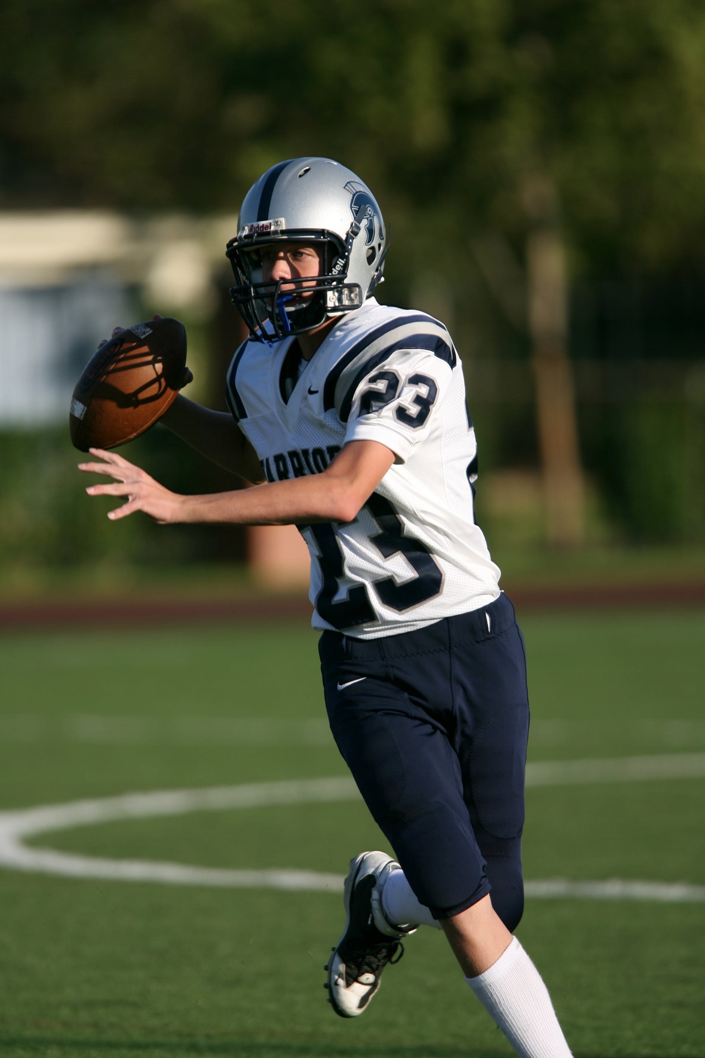 Kostenloses Stock Foto zu action, american football, athlet, ball