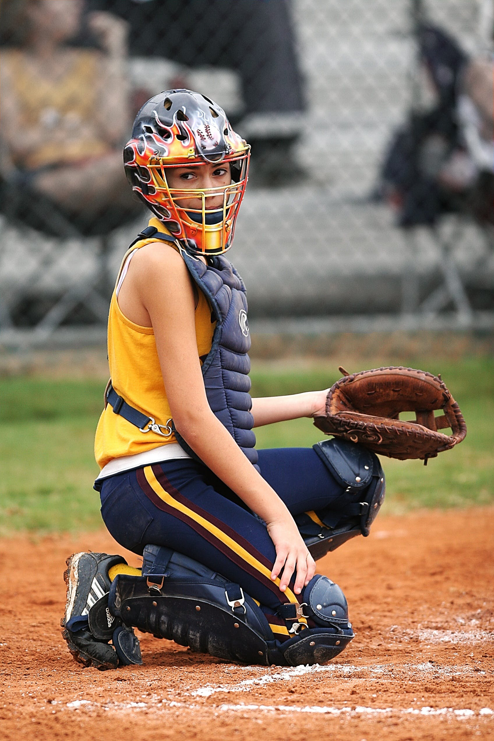 Female Baseball Catcher Portrait Photo during the Game at Daytime