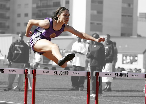 Woman in Purple Tank Top Run Olympics Games