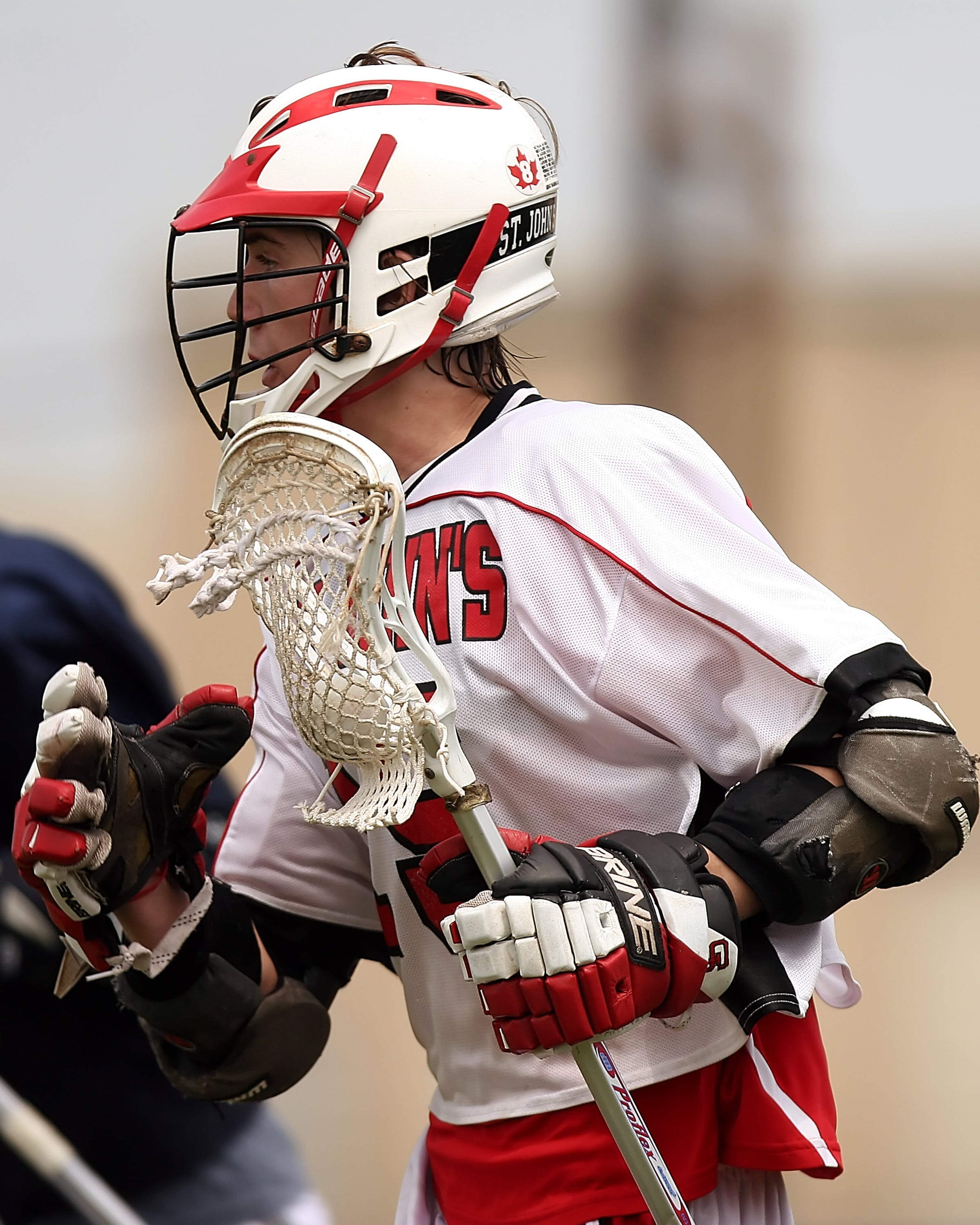 Man Wearing White and Red Lacrosse Uniform