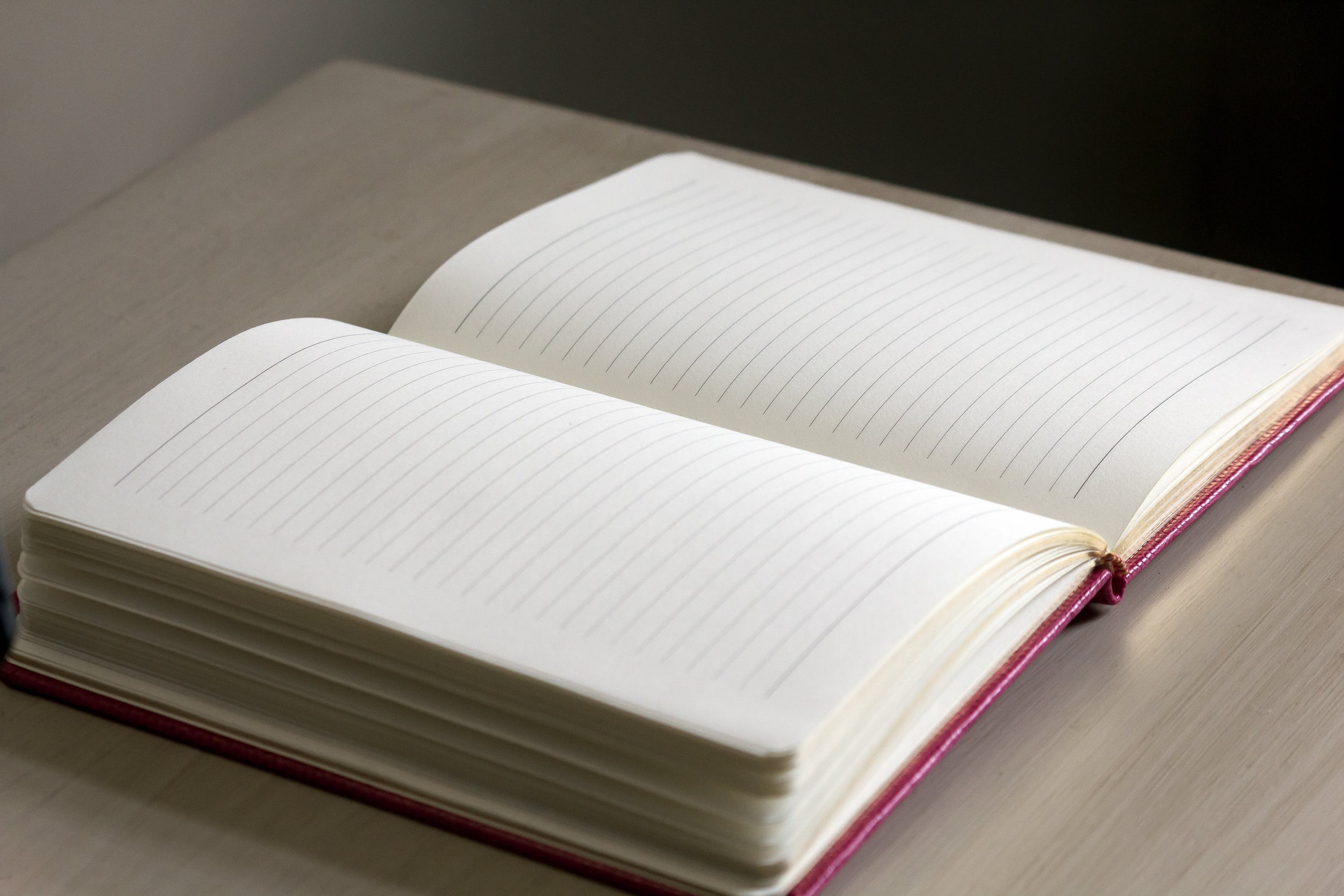 White Lined Notebook on Gray Table