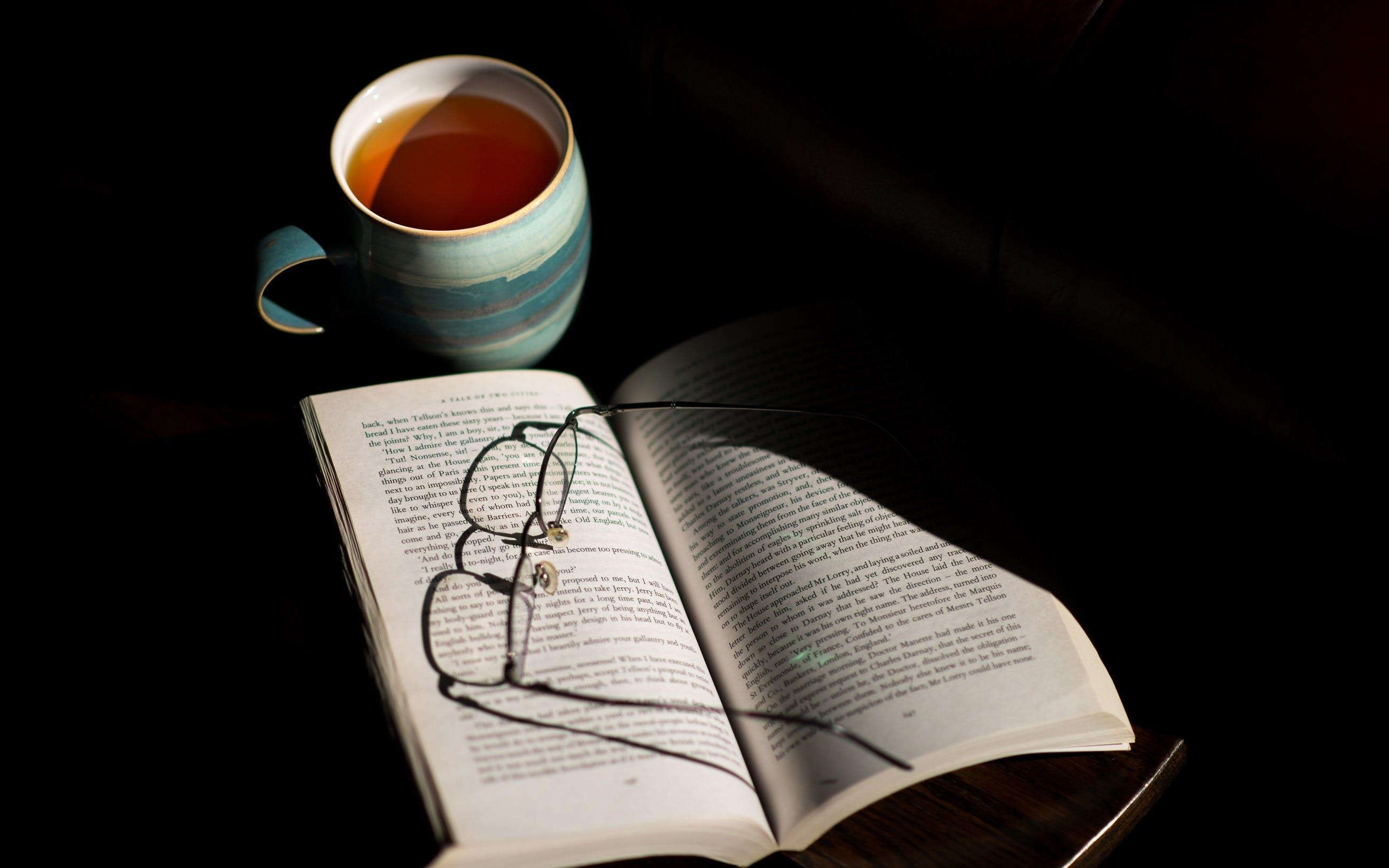 Eyeglasses on Open Book