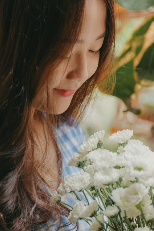Smiling Woman Holding White Mums Flower Bouquet