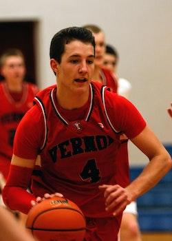 Man With Vernoa 4 Basketball Jersey Holding the Basketball