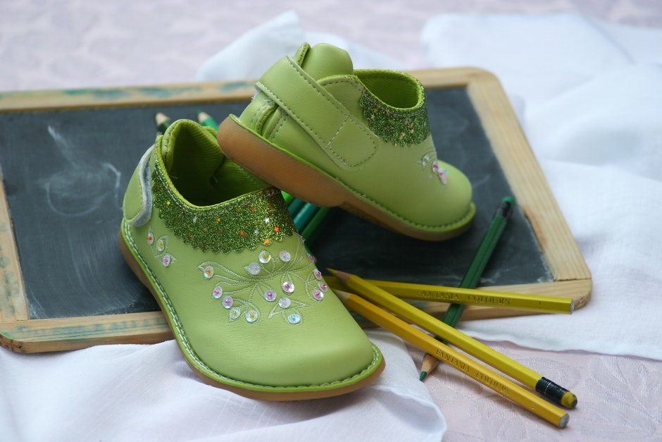Green Slip on Shoes Near Yellow and Green Pencil
