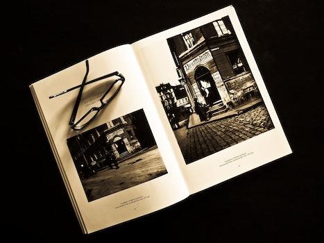 Black Framed Eyeglasses on White Photo Album
