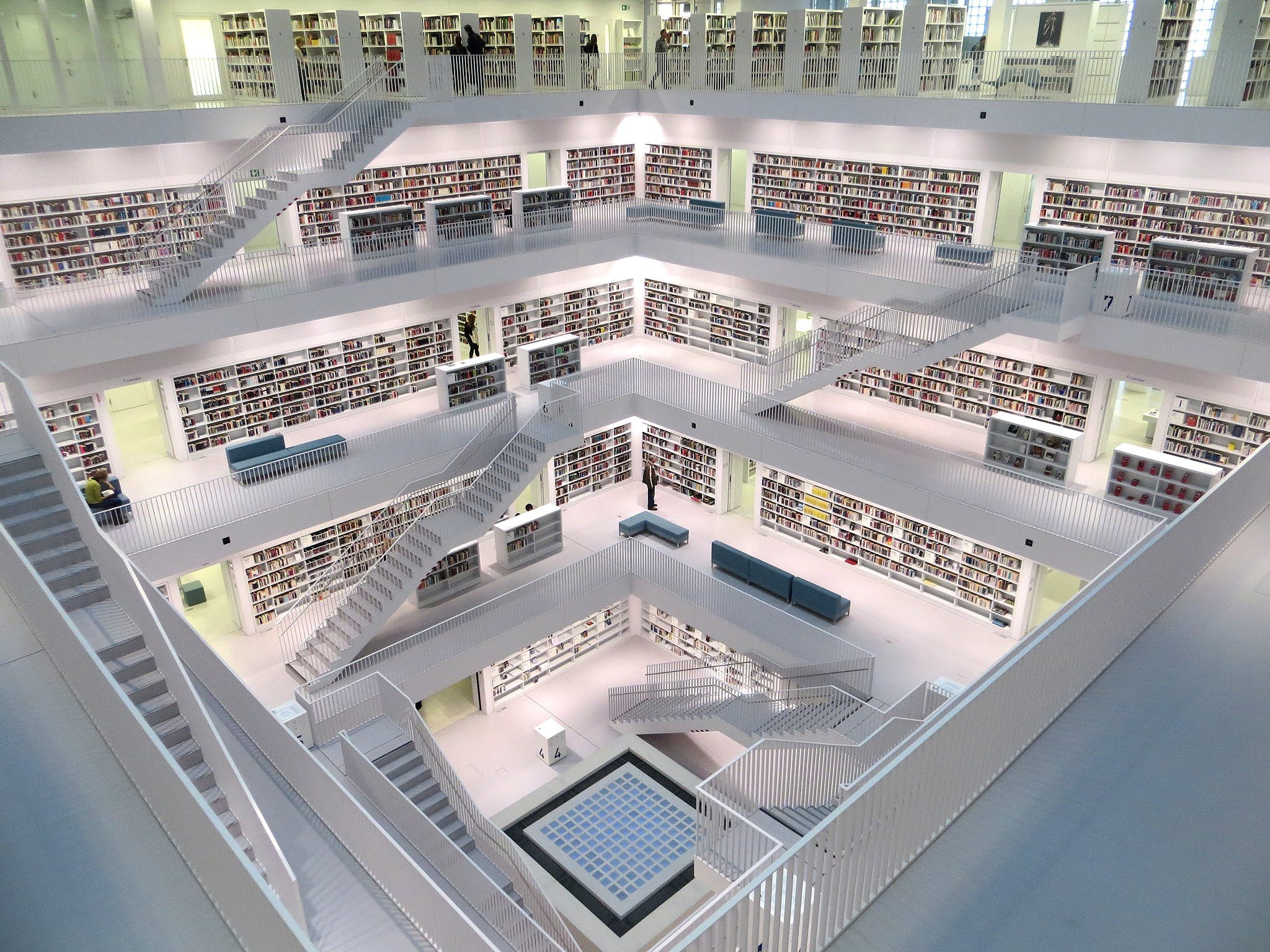 White Concrete Tall Building With Books