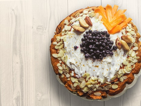 Pastry With Nuts Sliced Mangoes and Blackberries on Top