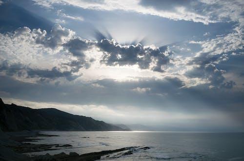 Foto d'estoc gratuïta de aigua, cel, Costa, mar