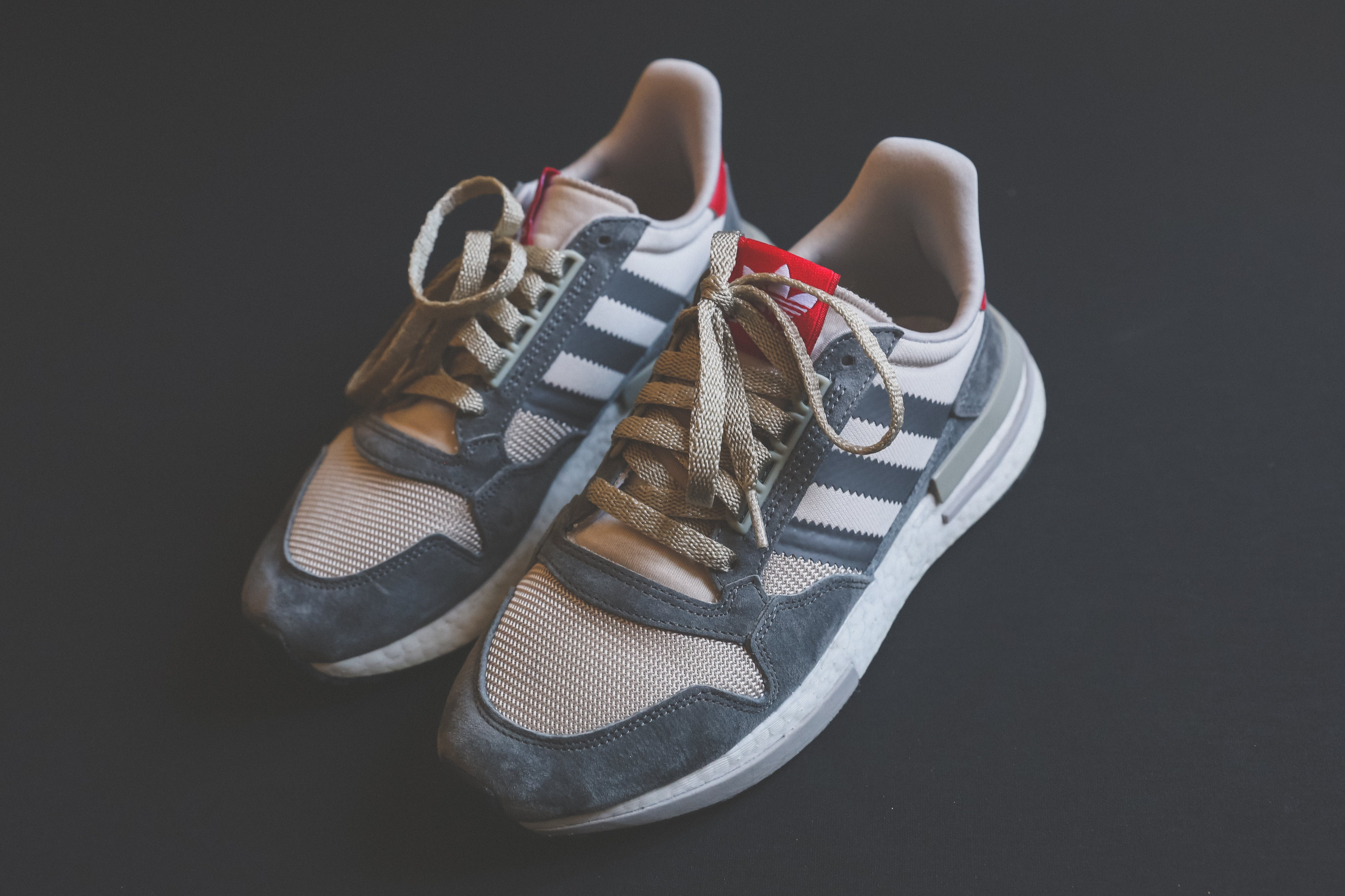 Close-Up Photo of Adidas Shoes