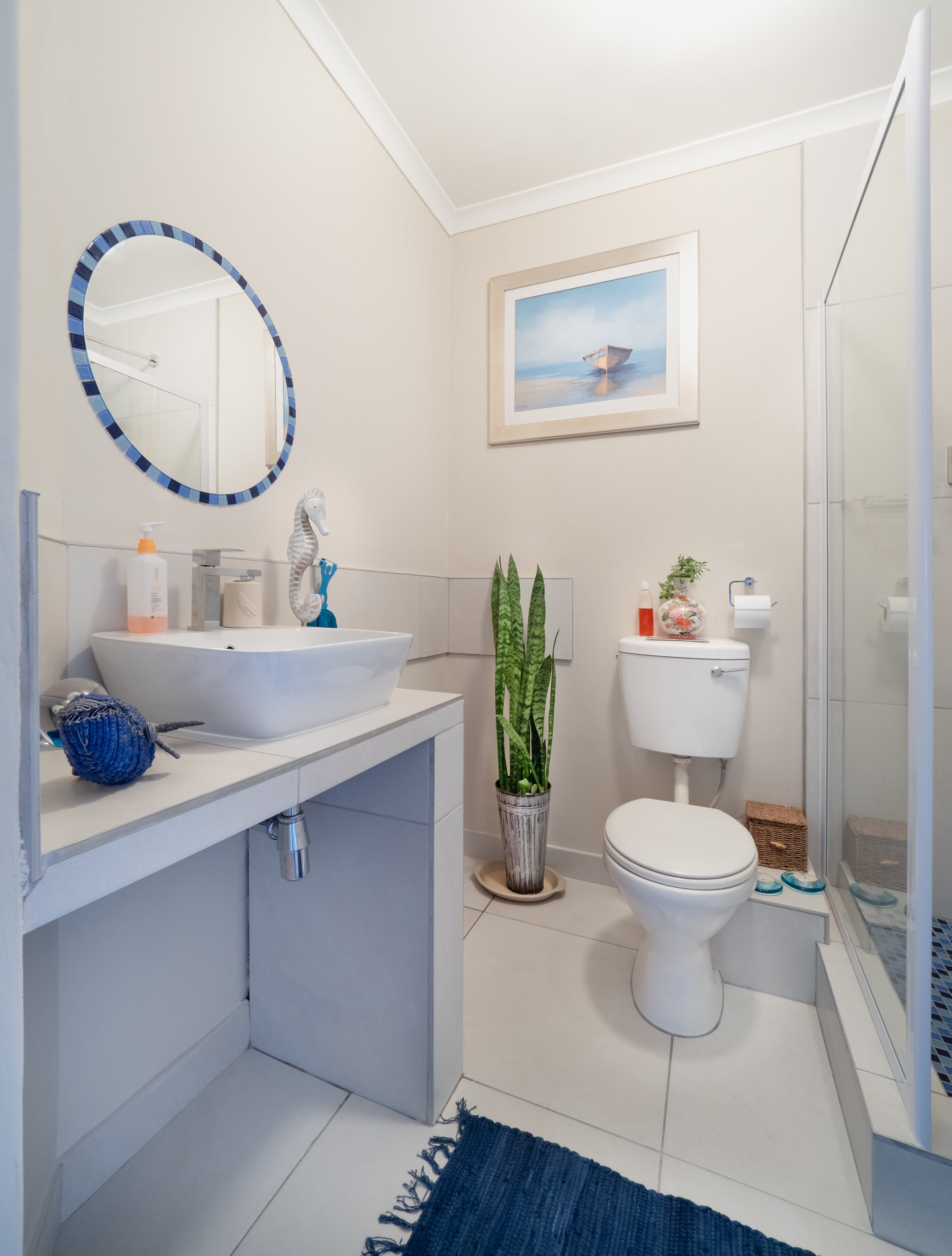 White Ceramic Toilet Bowl Beside Glass Wall