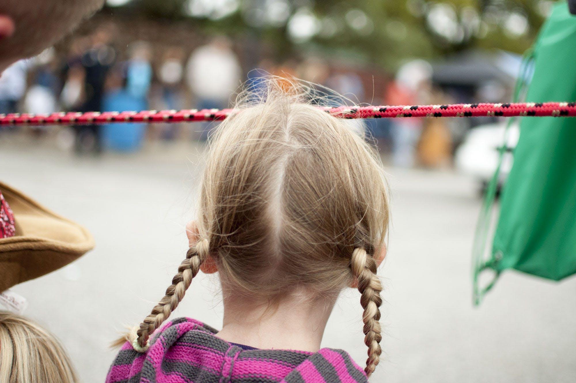 Free stock photo of blonde, girl, parade, Parade watching