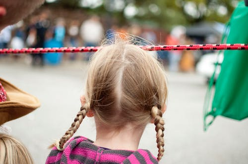 Free stock photo of blonde, girl, parade, Parade watching