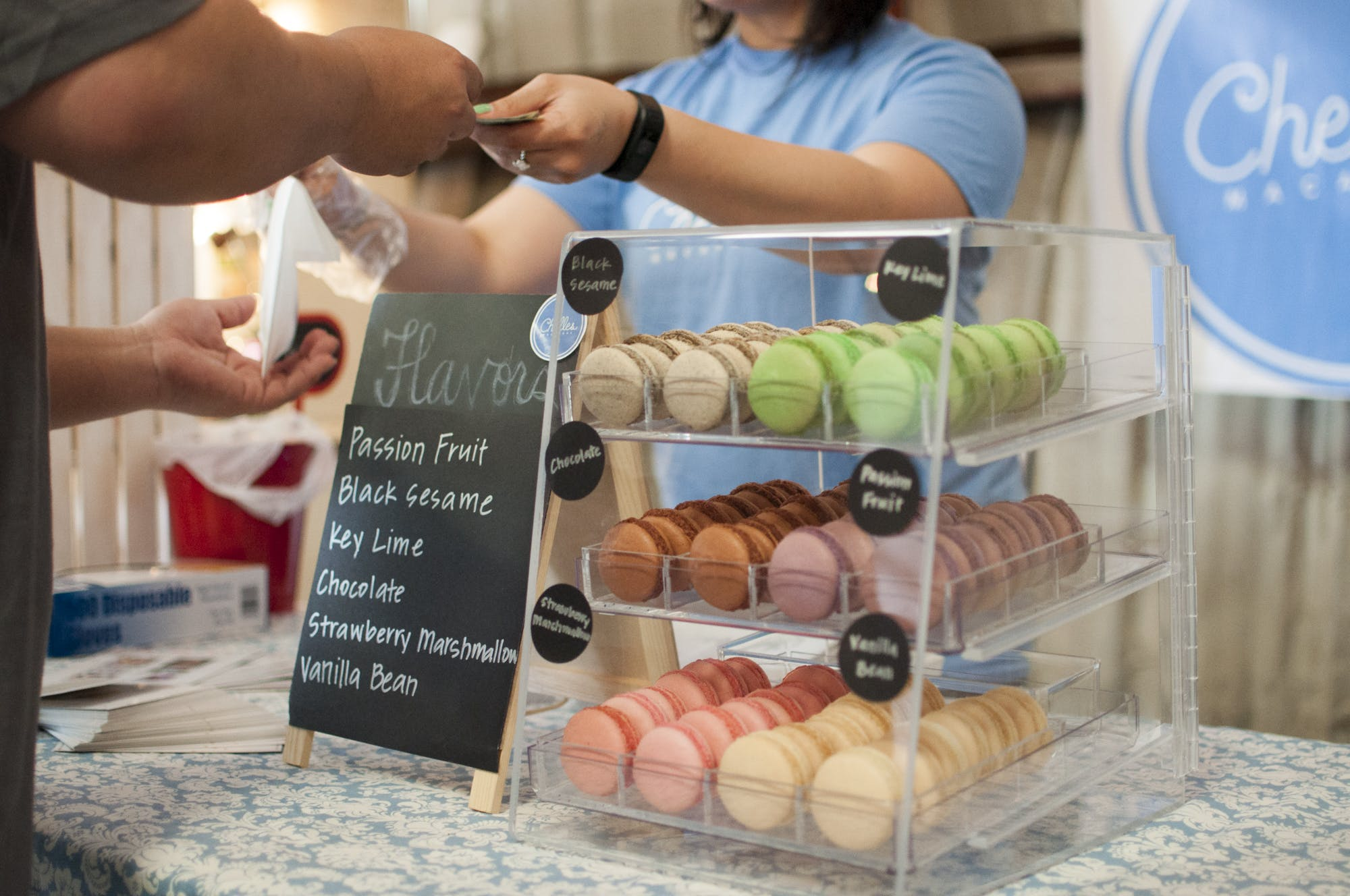 Black Sesame Key Lime Chocolate and Strawberry Macarons in a Glass Display