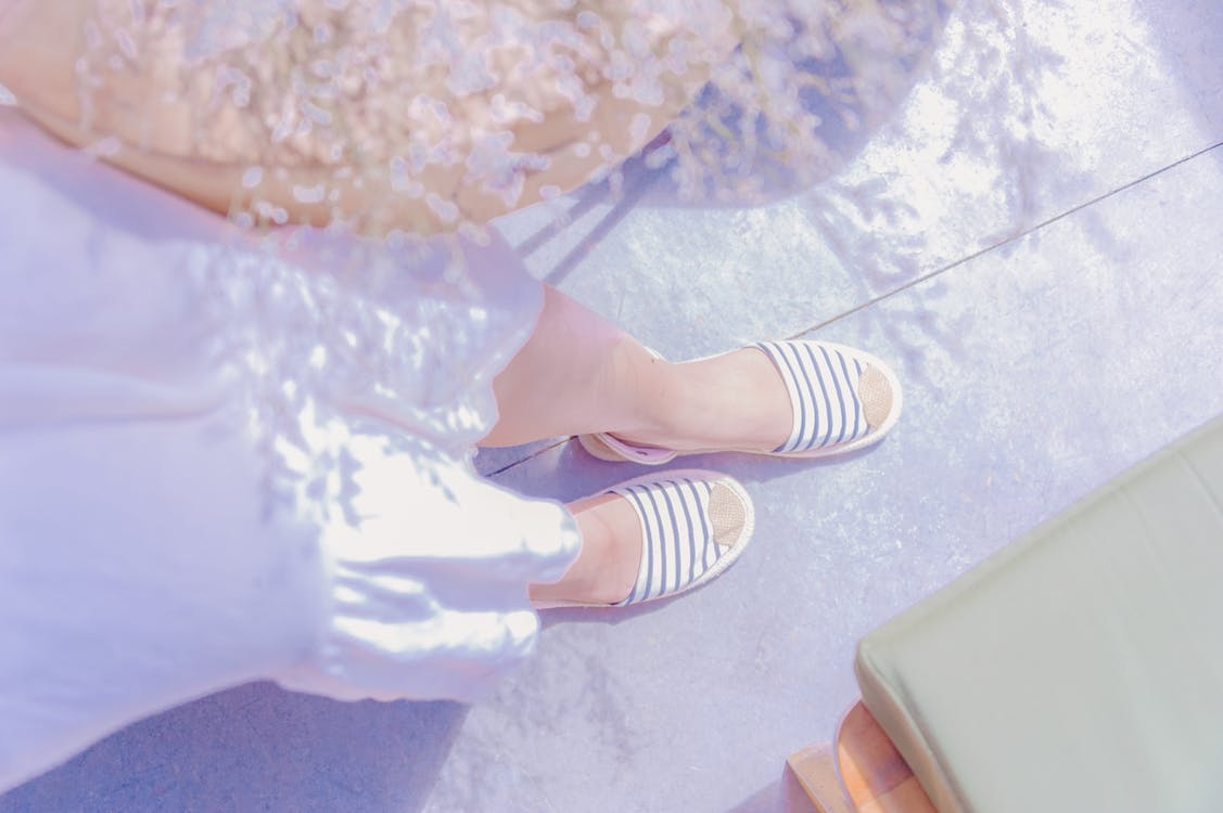 Pair Of White Striped Sandals