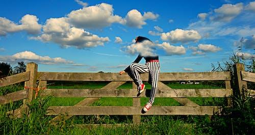 Free stock photo of body language, fashion, fence, people