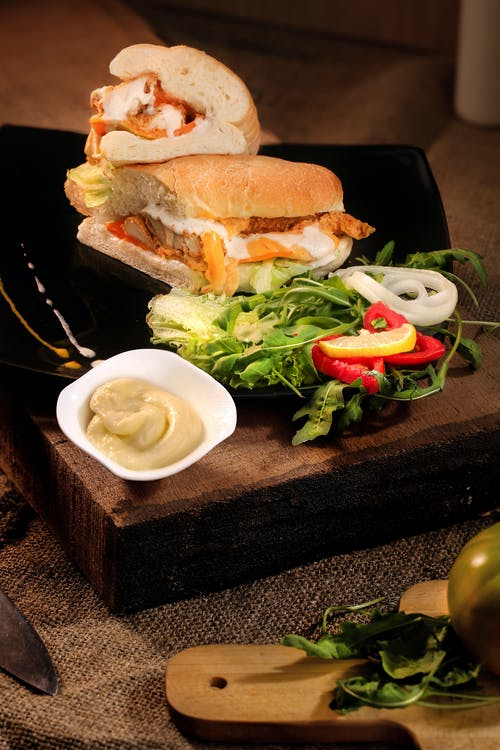 Sandwich On Brown Wooden Tray