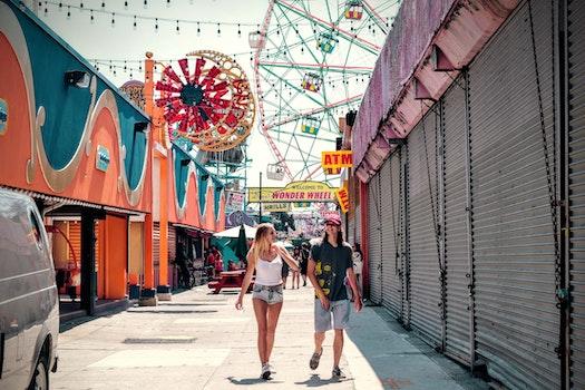2 Women Walking in the Carnival during Daytime