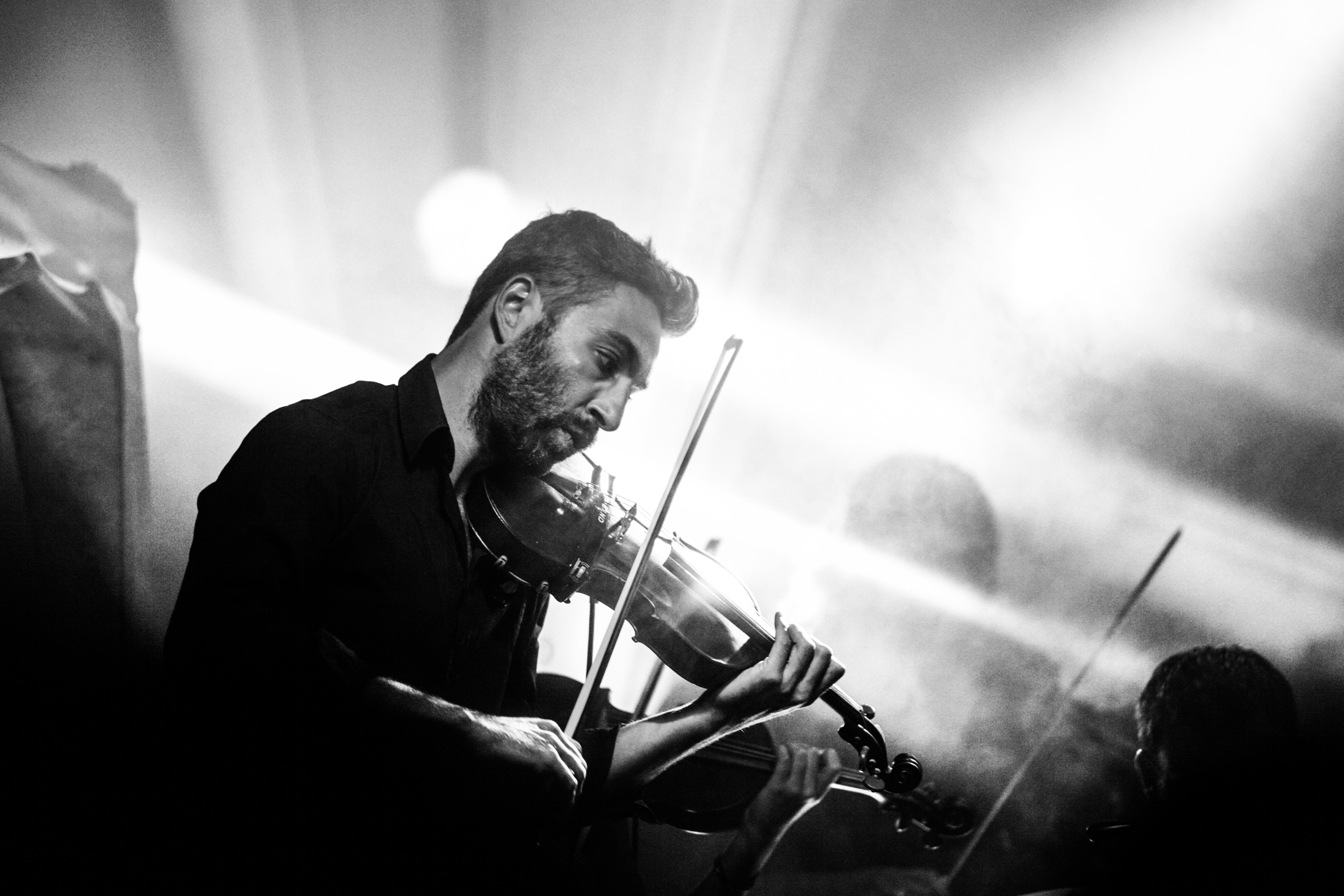 Greyscale Photography of Man Playing Violin