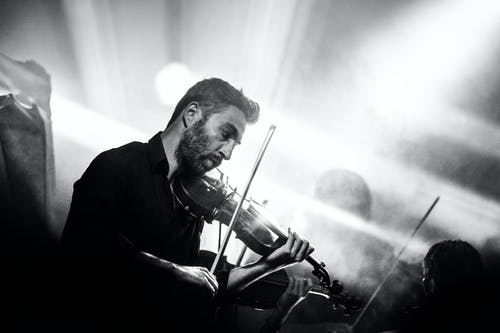 Greyscale Photography of Man Playing Violin