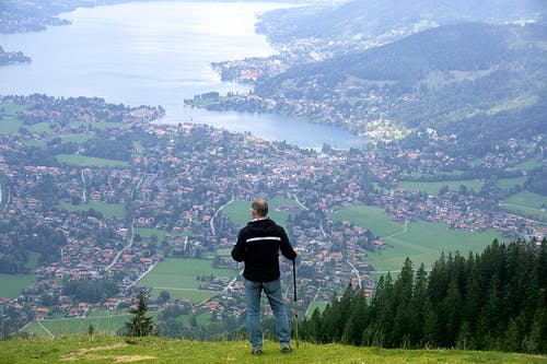 Man Standing on Green Grass