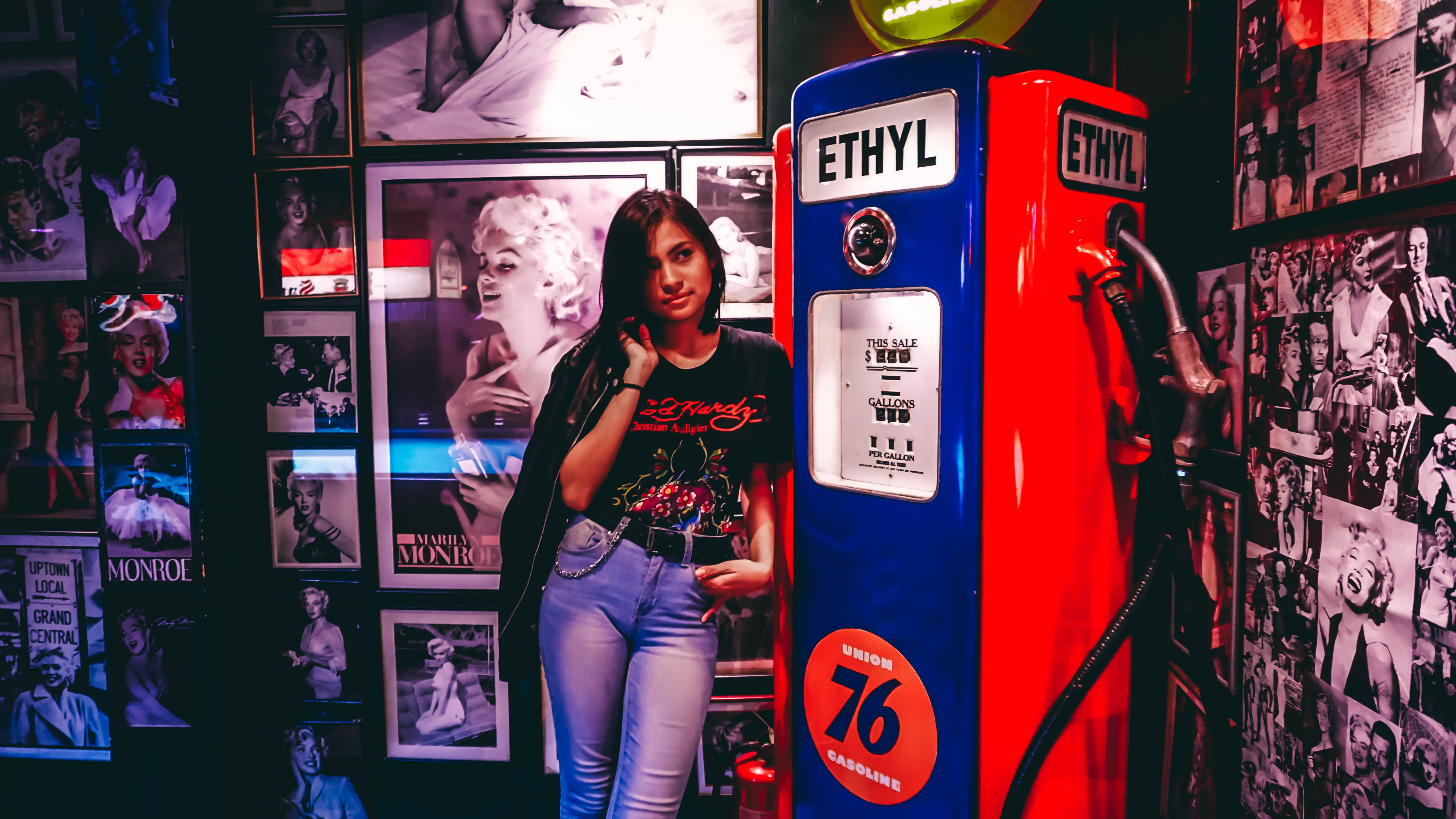 Woman Standing Beside Blue And Red Gas Pump