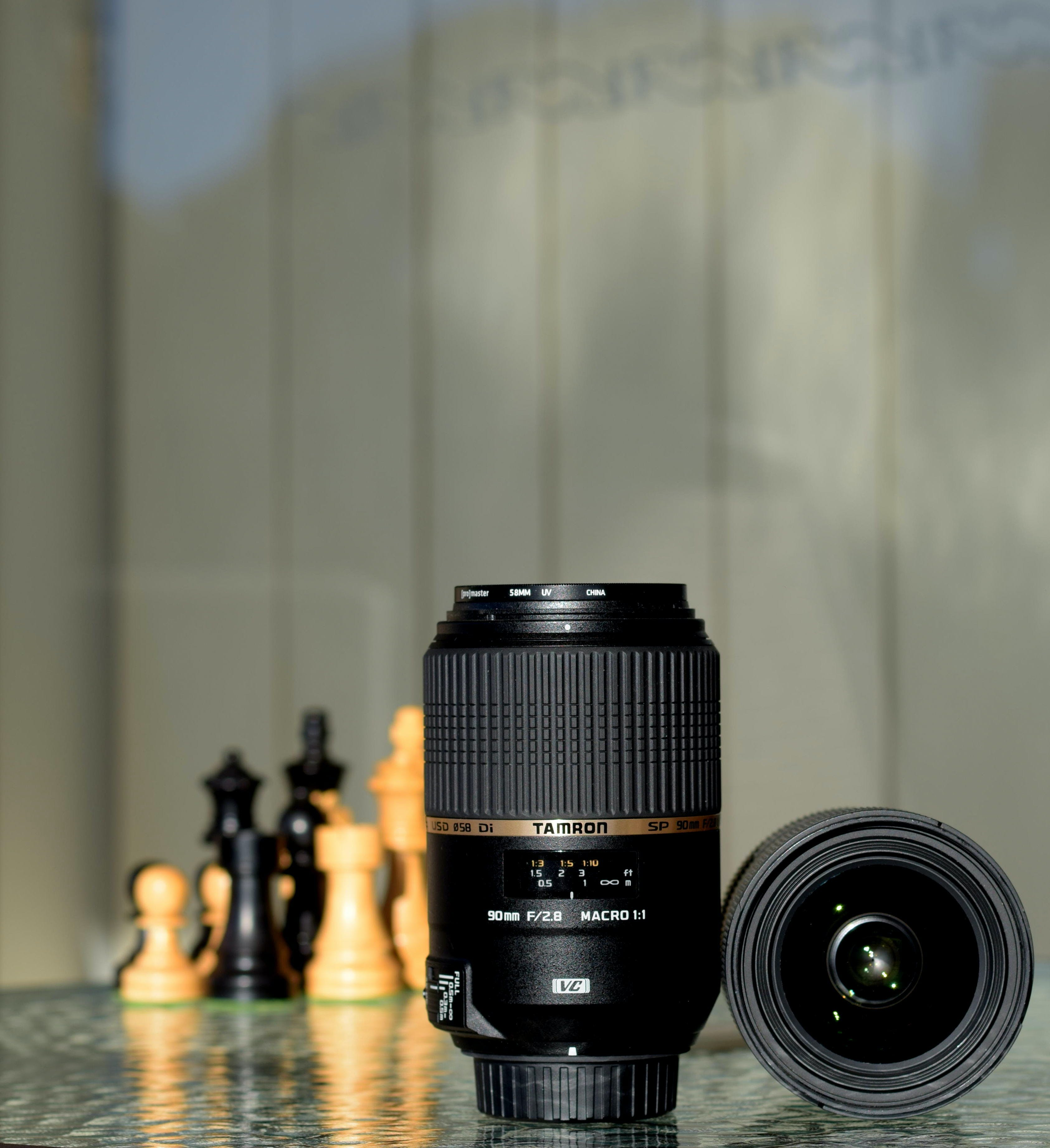 Two Black Zoom Lenses on Surface