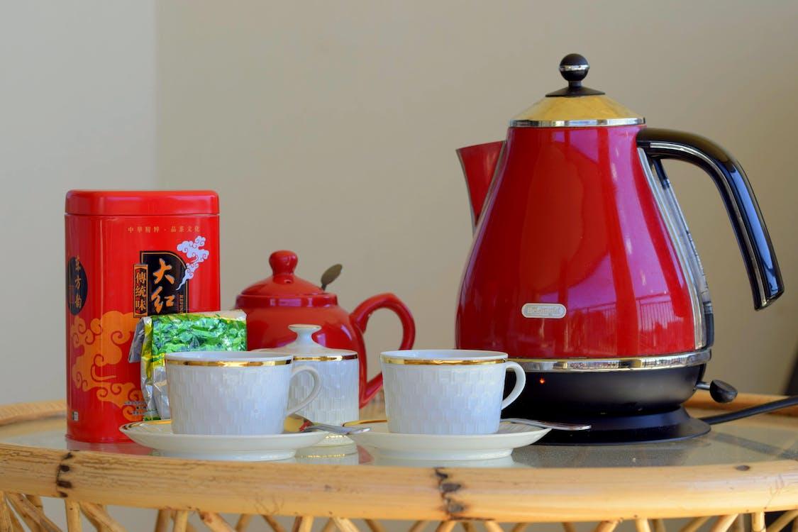 Red Kettle Beside White Teacups