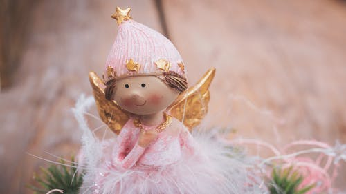 Selective Focus Photography Of Angel Ornament