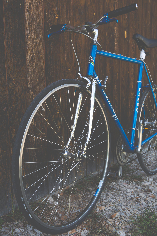 Blue City Bike Beside Brown Wooden Fence