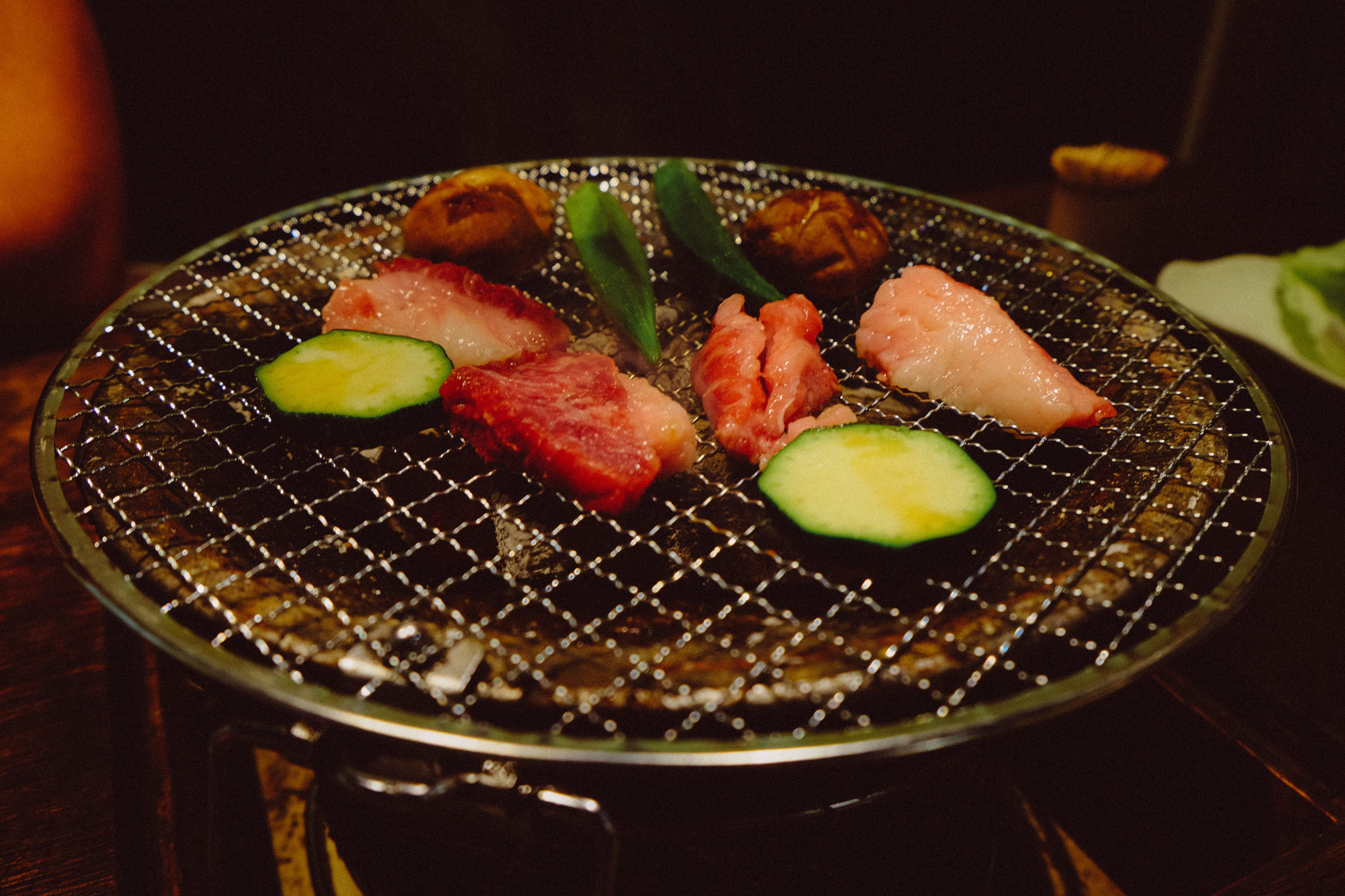 Raw Meat And Vegetable On Grill Pot