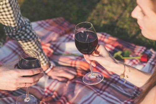 Two Person Holding Wine Glasses Outdoor