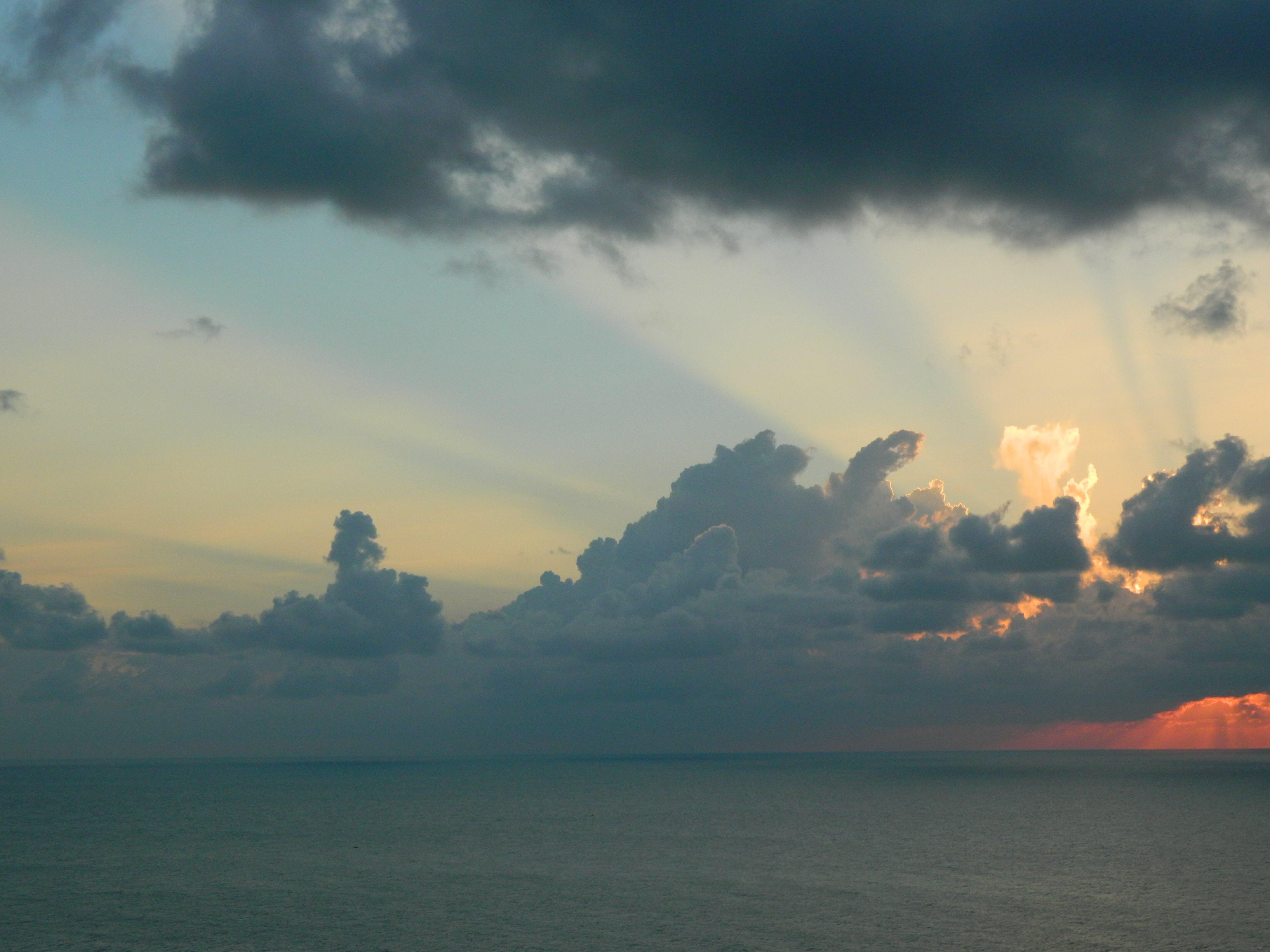 Wavy Ocean Under Gray Clouds
