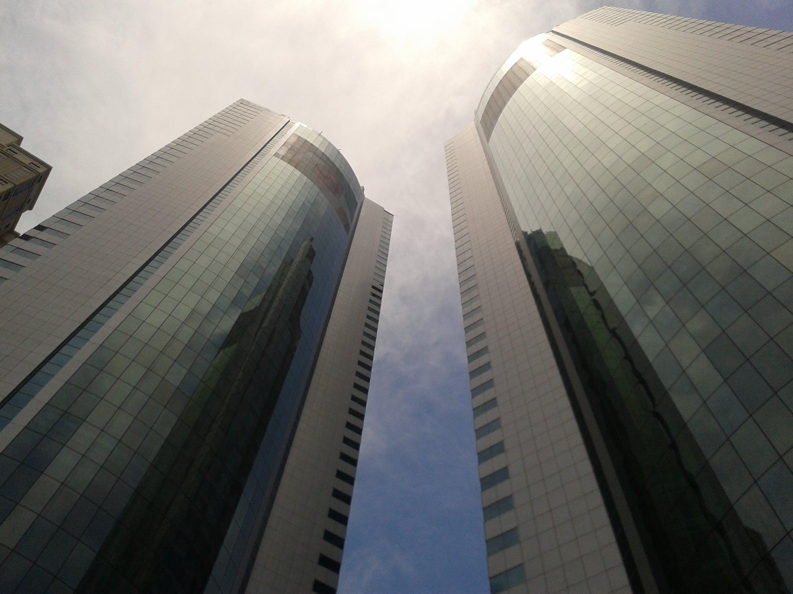 Low Angle Photo of Curtain Window Buildings